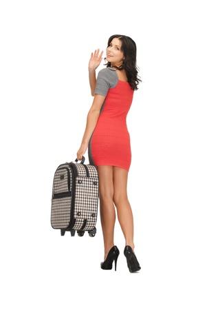 picture of happy woman with suitcase waving hand Stock Photo - 14186525