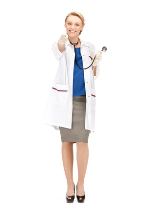 directing: picture of attractive female doctor pointing her finger Stock Photo
