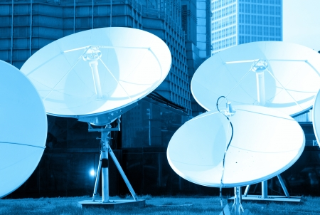 telecast: blue toned picture of parabolic satellite dish space technology receivers