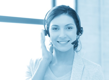 blue toned picture of friendly female helpline operator photo