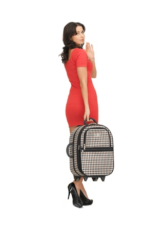 bright picture of unhappy woman with suitcase waving hand Stock Photo - 14187713