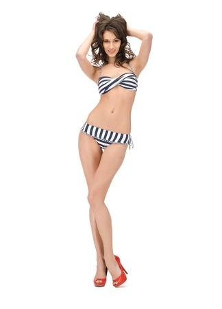 bright picture of beautiful woman in bikini and high heels photo