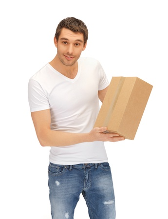 order shipment: handsome man in white shirt with parsel Stock Photo