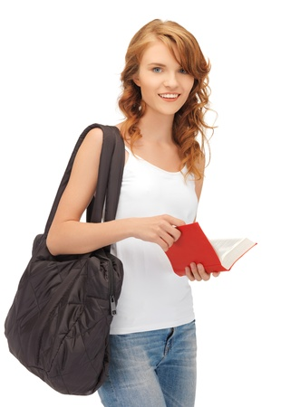happy teenage girl in blank white t-shirt with book photo