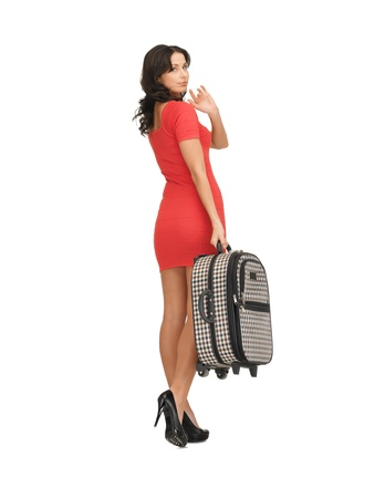 bright picture of unhappy woman with suitcase waving hand Stock Photo - 14288408