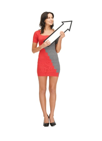 direction of the arrow: picture of happy woman with direction arrow sign Stock Photo