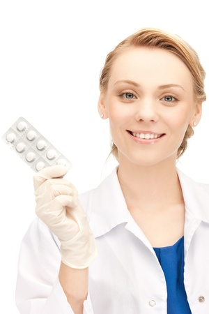 birth prevention: picture of attractive female doctor with pills