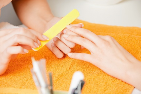 beauty parlor: closeup picture of manicure process on female hands