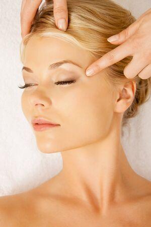 picture of calm beautiful woman in massage salon photo