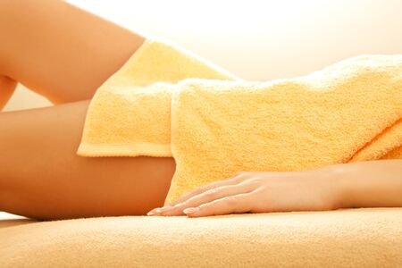 closeup picture of female hands and legs in spa salon photo