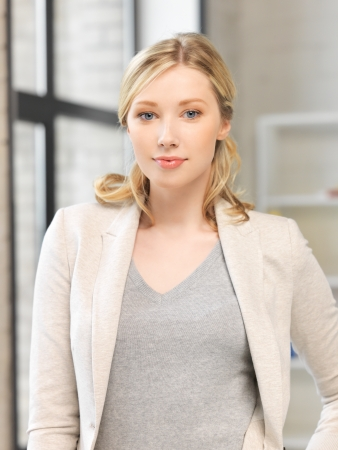 young office workers: bright picture of calm and serious woman Stock Photo