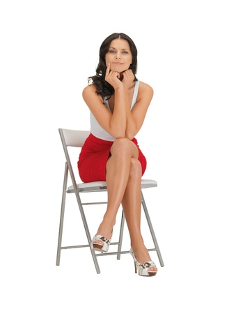 bright picture of pensive woman on a chair photo