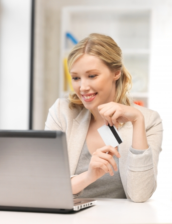 picture of happy woman with laptop computer and credit card Stock Photo - 14361277