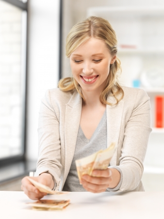 picture of lovely woman counting euro cash money photo