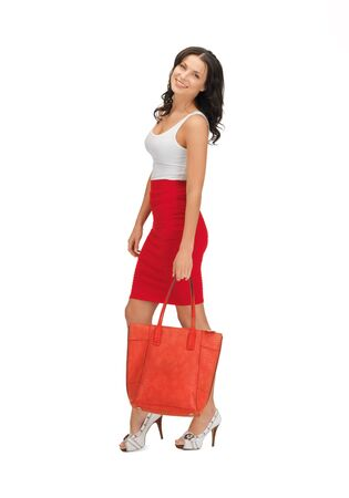 picture of lovely woman in dress with a bag photo