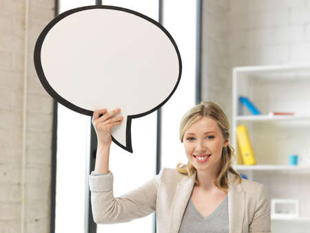 scholar: bright picture of smiling businesswoman with blank text bubble Stock Photo