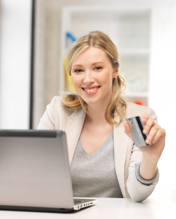 picture of happy woman with laptop computer and credit card Stock Photo - 14464808