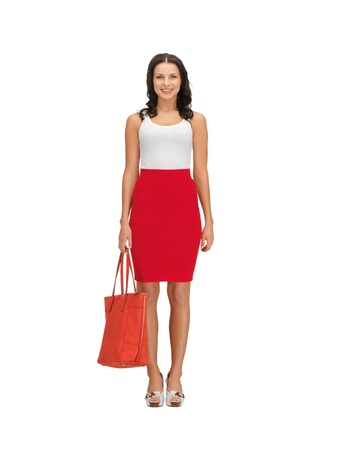 woman standing: picture of lovely woman in dress with a bag