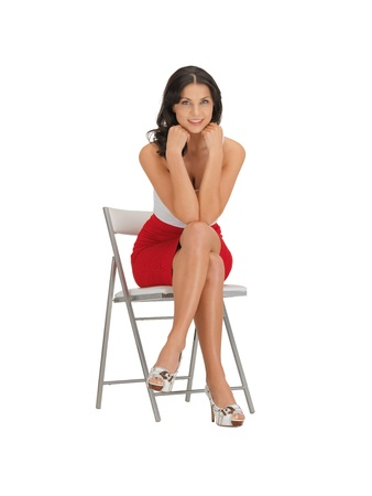 stool: happy woman in dress on a chair