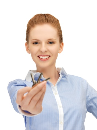 bright picture of happy woman with keys photo