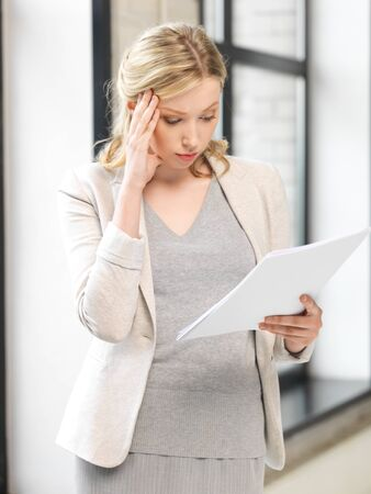 indoor picture of worried woman with documents Stock Photo - 14504040