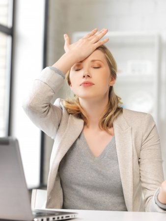 picture of stressed woman with laptop computer photo