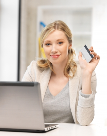 picture of happy woman with laptop computer and credit card Stock Photo - 14504076