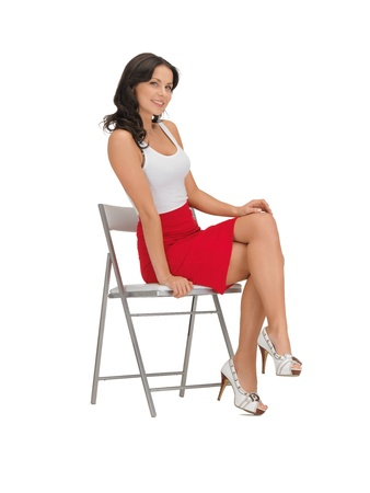 girl sit: happy woman in blank white t-shirt on a chair