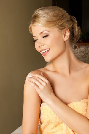 parlor: picture of attractive woman applying skin creme Stock Photo
