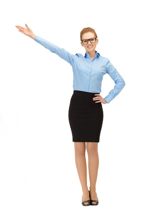 business direction: picture of businesswoman in specs pointing her hand