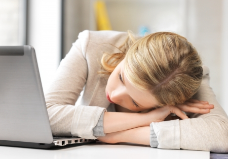 discouraged: picture of tired woman with laptop computer