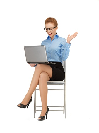 nerd girl: picture of woman with laptop computer in specs Stock Photo
