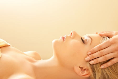 aging woman: picture of calm beautiful woman in massage salon Stock Photo