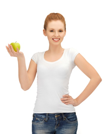 happy teenage girl with green apple  photo