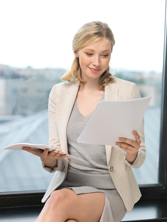 indoor picture of happy woman with documents photo
