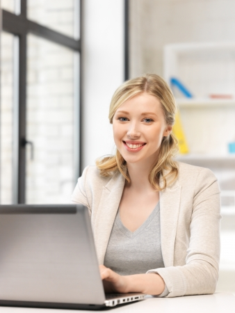 bright picture of happy woman with laptop computer Stock Photo - 14569764
