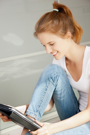 picture of happy teenage girl with tablet pc computer photo