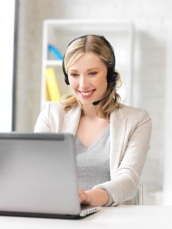 telephone headsets: picture of helpline operator with laptop computer  Stock Photo