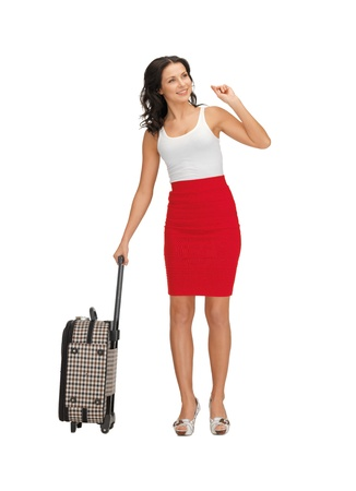 bright picture of hitch-hiking woman with suitcase photo