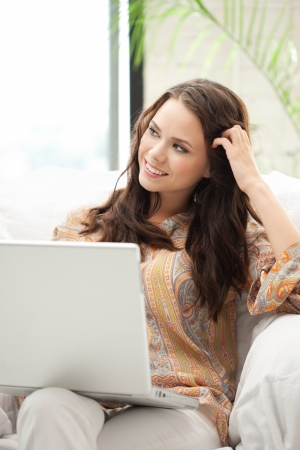 attractive gorgeous: picture of happy woman with laptop computer Stock Photo