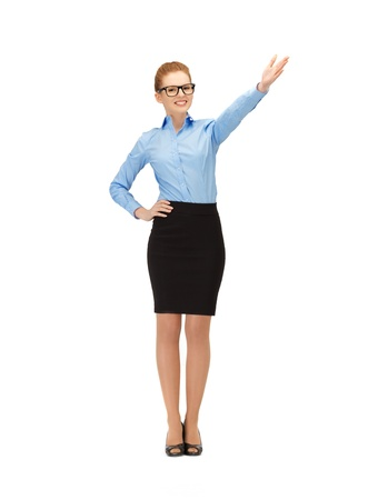 picture of businesswoman pointing her hand in specs Stock Photo - 14635223