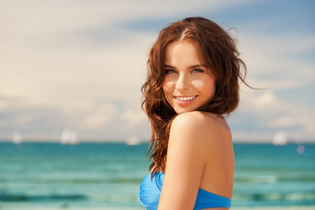 releaxed: bright picture of happy smiling woman on the beach  Stock Photo