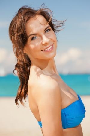 blue bikini: bright picture of beautiful woman on a beach