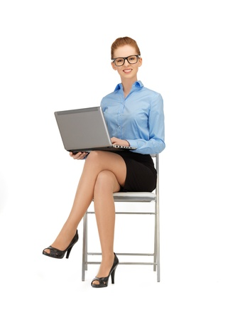 picture of woman with laptop computer in specs photo