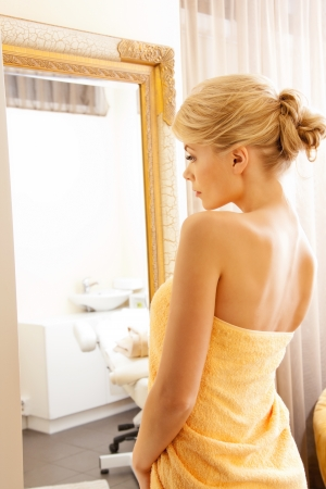 soft skin: picture of beautiful woman in spa salon with mirror