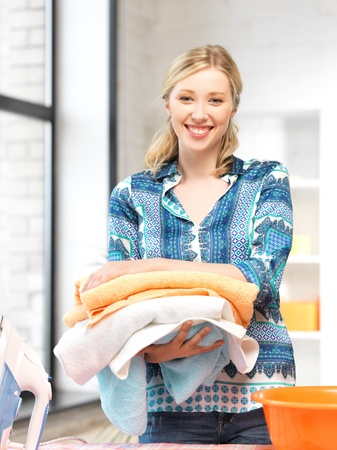 bright picture of lovely housewife with towels Stock Photo - 14730348