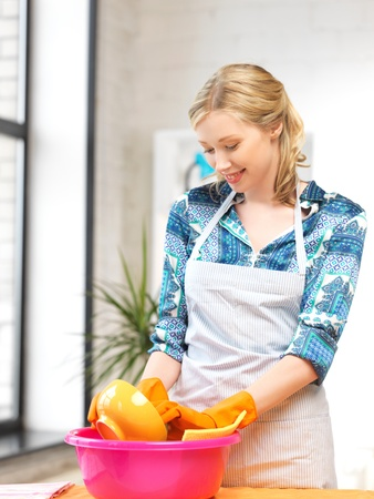 picture of beautiful housewife washing dish at the kitchen    photo