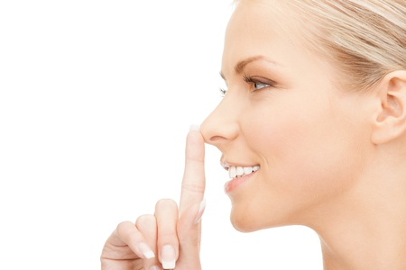 picture of happy woman with finger on lips Stock Photo - 14729771