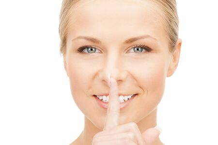 picture of happy woman with finger on lips Stock Photo - 14730371