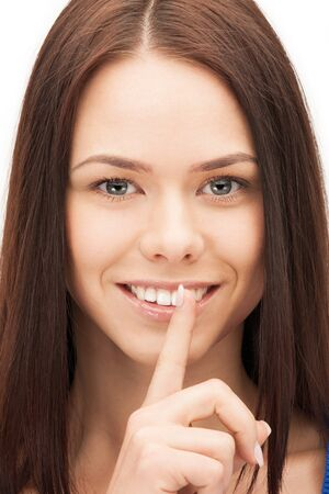 picture of happy woman with finger on lips Stock Photo - 14730461